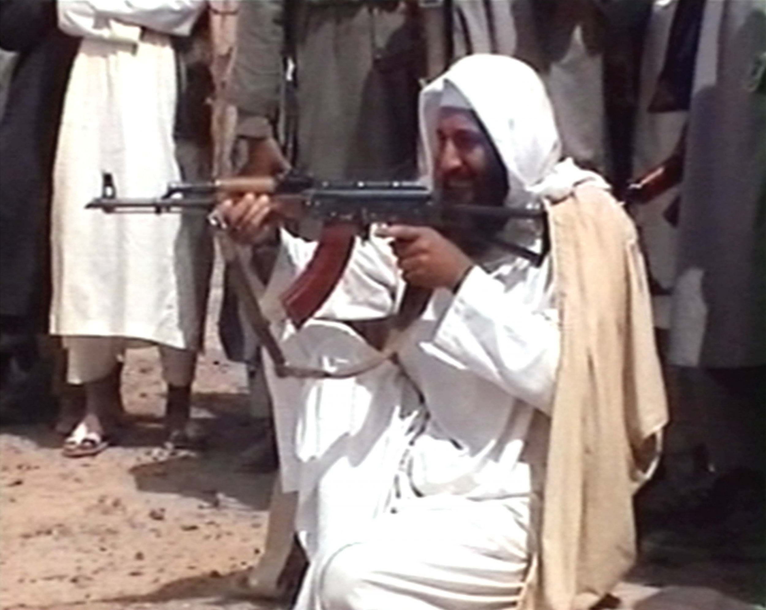 Terrorist Osama Bin Laden with ak-47