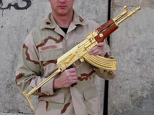 An american soldier with an Iraqi golden AK-47
